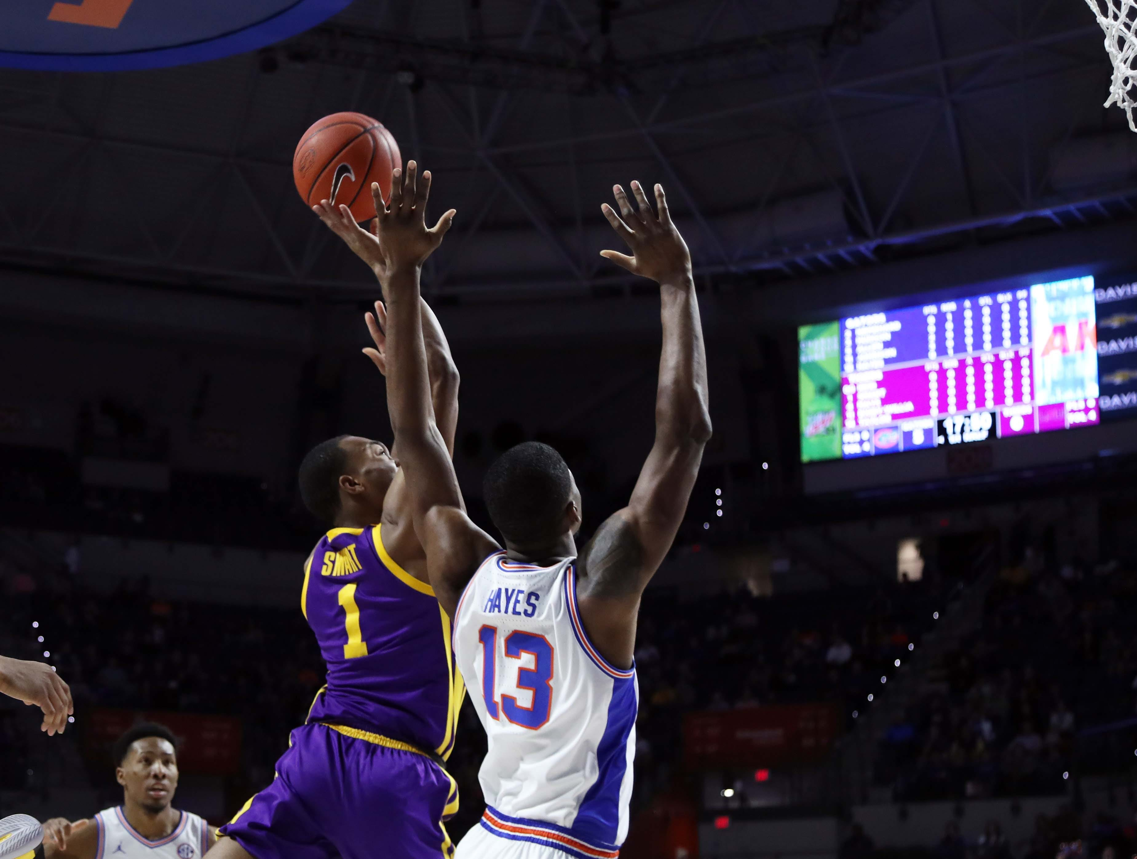 Mar 6, 2019; Gainesville, FL, USA; LSU Tigers guard Javonte Smart (1) shoots over Florida Gators center Kevarrius Hayes (13)  during the first half at Exactech Arena. Mandatory Credit: Kim Klement-USA TODAY Sports