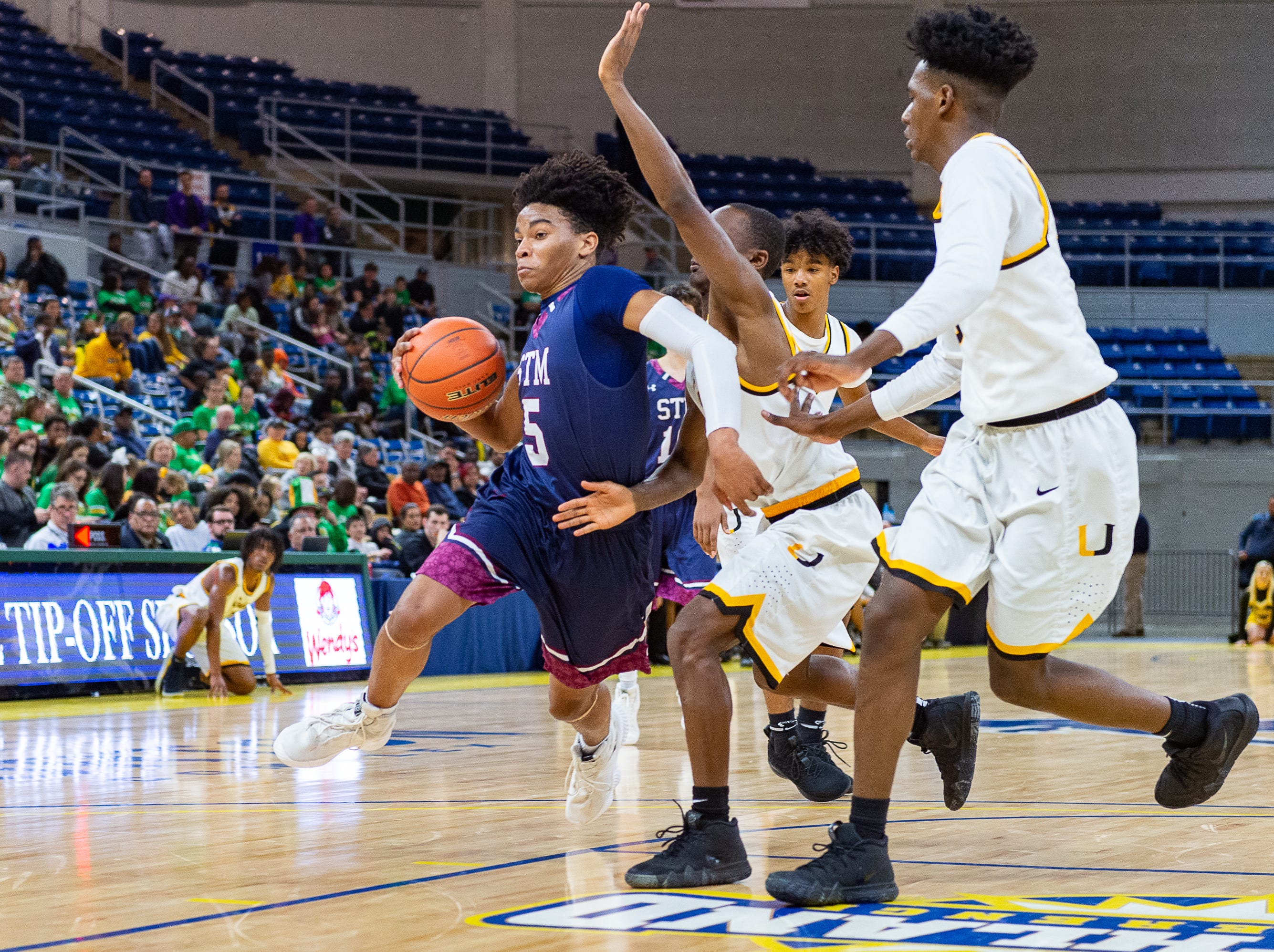 Jaden Shelvin drfives to the basket as STM takes down University High in the semi final round of the LHSAA Basketball State Championships. Wednesday, March 6, 2019.