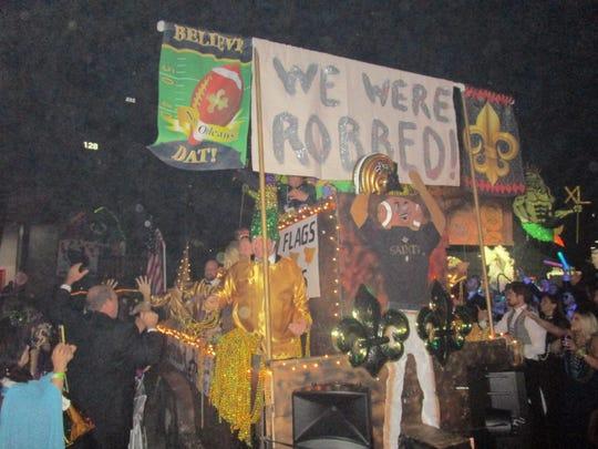 A Saints themed float parades through the Cajundome.