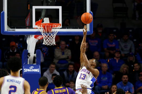 Mar 6, 2019; Gainesville, FL, USA; Florida Gators center Kevarrius Hayes (13) shoots over LSU Tigers forward Kavell Bigby-Williams (11) during the first half at Exactech Arena. Mandatory Credit: Kim Klement-USA TODAY Sports