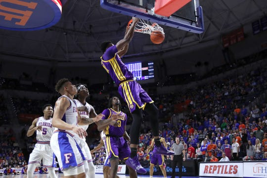 Mar 6, 2019; Gainesville, FL, USA;LSU Tigers forward Kavell Bigby-Williams (11) dunks the ball against the Florida Gators during the first half at Exactech Arena. Mandatory Credit: Kim Klement-USA TODAY Sports