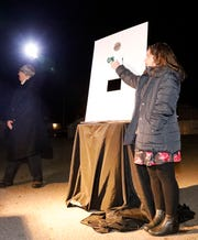 Mount Pleasant Elementary Lillian Kennedy flips a ceremonial light switch during the lighting of Mount Pleasant Wednesday, March 6, 2019, in Lancaster.