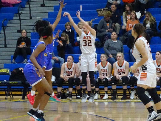Amanda-Clearcreek's Alyssa Evans shoots a 3-pointer during the Aces' Division III regional semifinal against Cincinnati Purcell Marian Wednesday night at Springfield High School. The Aces fell 52-30.