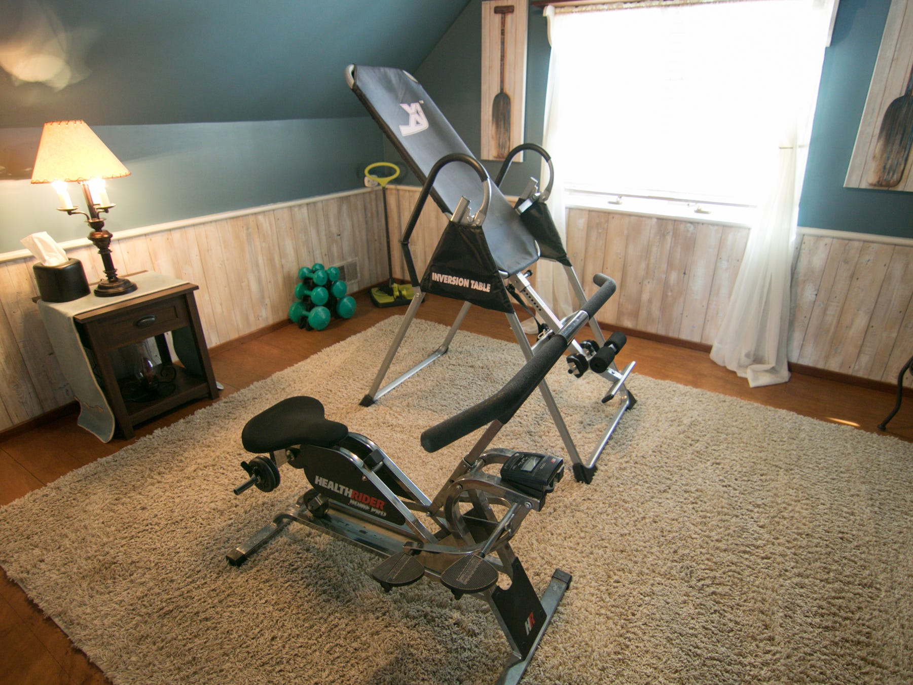 A spare bedroom serves as an exercise room in the Olmsted home, shown Thursday, March 7, 2019.
