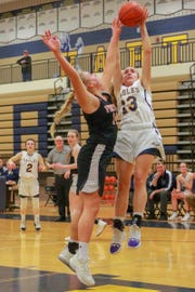Hartland's Madi Moyer is fouled by Fenton's Chloe Idoni in a district basketball semifinal on Wednesday, March 6, 2019.
