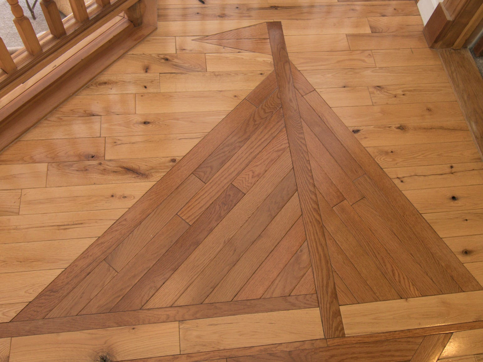 A sailboat image is inlaid into the hardwood floor of the Olmsted home on Patterson Lake, shown Thursday, March 7, 2019.