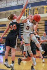 Hartland's Leah Lappin (3) goes to the basket while defended by Fenton's Erin Carter in a district basketball semifinal on Wednesday, March 6, 2019.