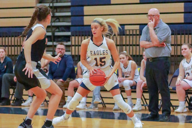 Hartland coach Don Palmer looks on as Lauren Sollom controls the basketball in a 43-22 victory over Fenton in a district semifinals on Wednesday, March 6, 2019.