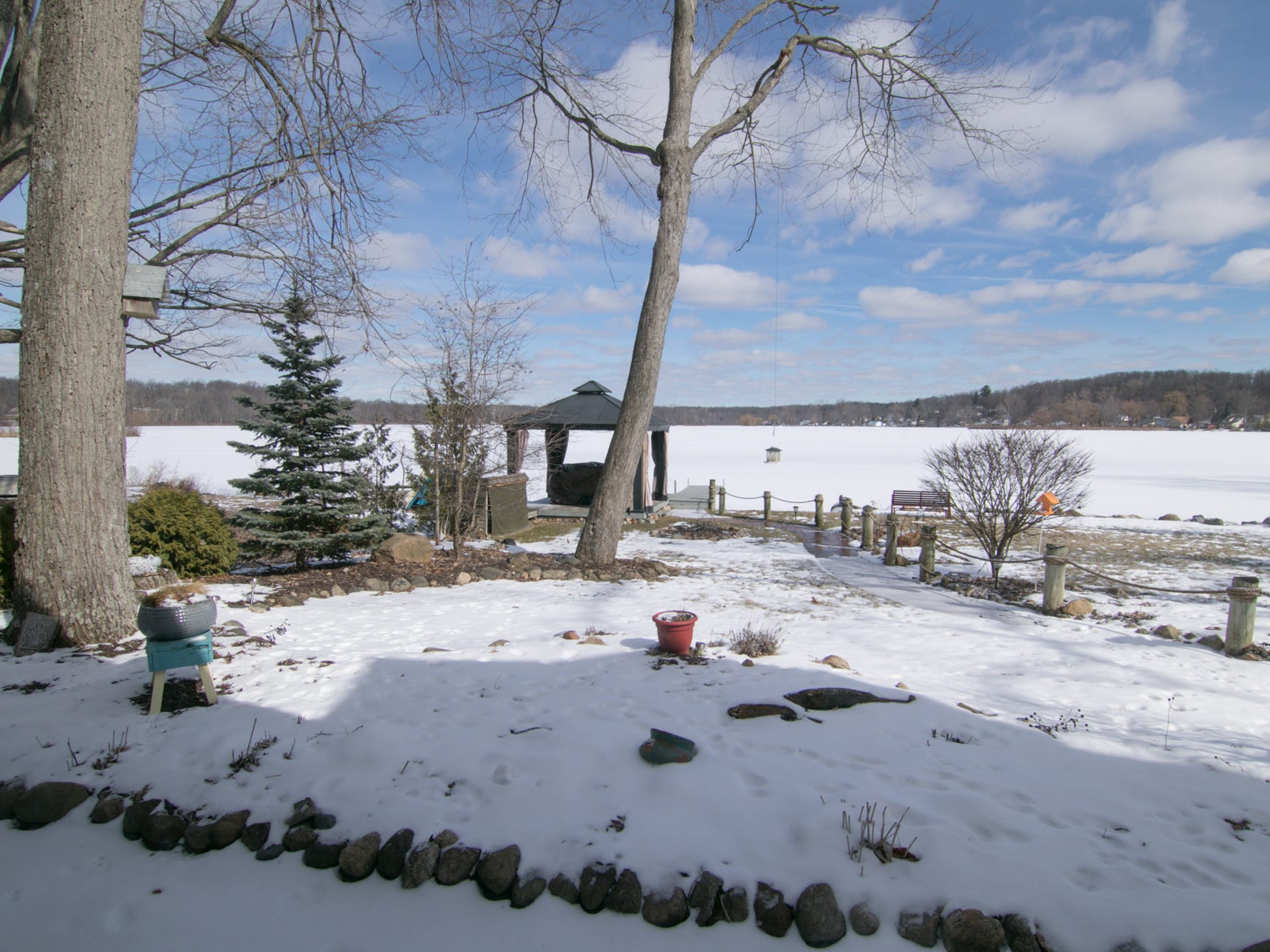 Views of Patterson Lake are readily available from the living room of the Olmsted home, shown Thursday, March 7, 2019.