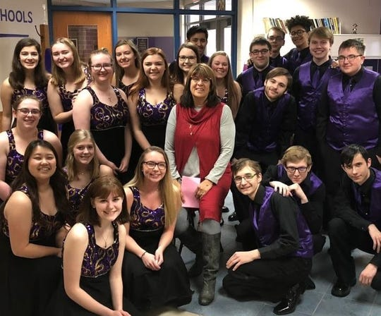 Show Choir with Two Rivers District Administrator Lisa Quistorf in center. Row one, from left: Emily Naegele, Hailey Heier, Colin Dombrowski, Noah Babich and Cameron Powell. Row two, from left: Rachel Lee and Morgan Hansen. Row three, from left: Hannah Niemojuski, Breana Fallon, Autumn Mueller, Carmen Neumann, Chloe Parma, Jake Puestow and Karter Mueller. Row four, from left: Rosie Ehle, Cassie Wanek, Kala Peterson, Dustin White and Donny Heinsohn. Row five, from left: Blas Guzman, Traven Denault, and Kaleb Loyd.