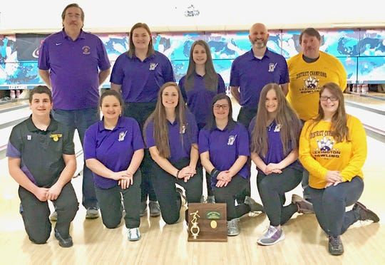 Lexington's district champion girls team is the first team in school history to qualify for the state tournament and the girls will be joined in Columbus by junior Scott Oliver, the first male qualifier from Lex. Directly behind the district title plaque are district champ Brittany Salimbene, left, and district runner-up Payge Whitesel.