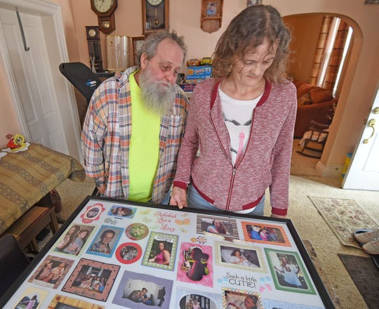 Robert Leicy and Cindy Tilton look at photos of his daughter Rebekah Leicy. Serial killer Shawn Grate pleaded guilty to Rebekah's murder but Robert and Cindy do not believe Grate was her killer.