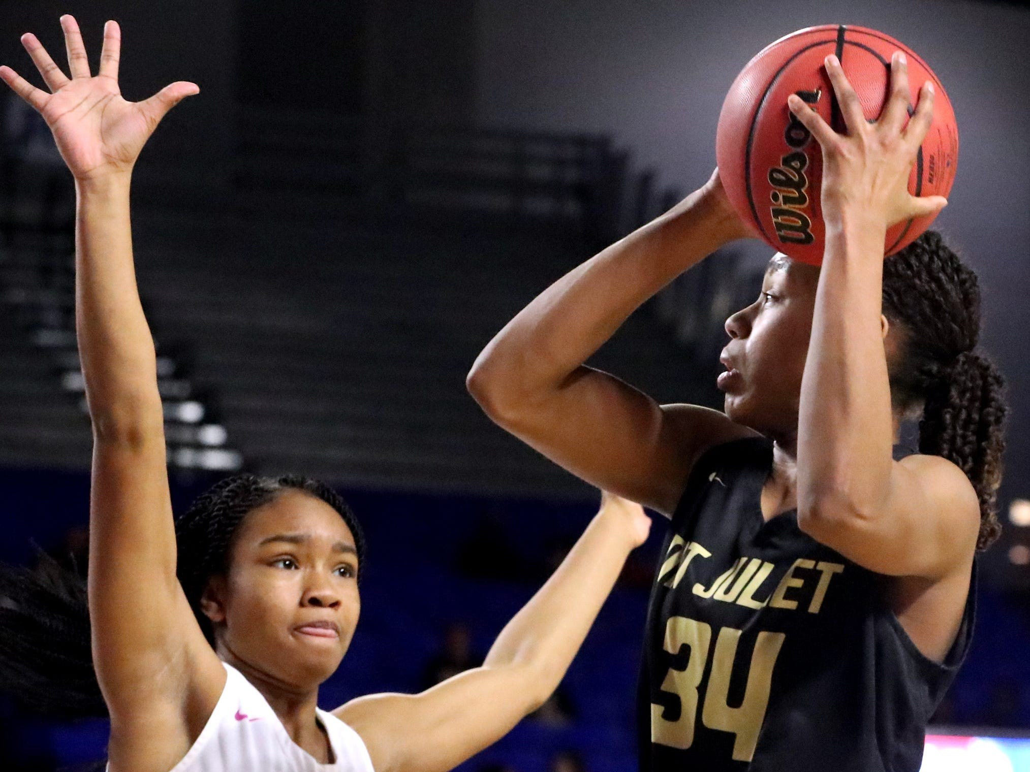 Mt. Juliet's Tondriannha Davis (34) shoots the ball as Houston's Aliyah Wilson (10) guards her during the quarterfinal round of the TSSAA Div. 1 Class AAA Girls State Tournament, on Wednesday, March 6, 2019, at Murphy Center in Murfreesboro, Tenn.