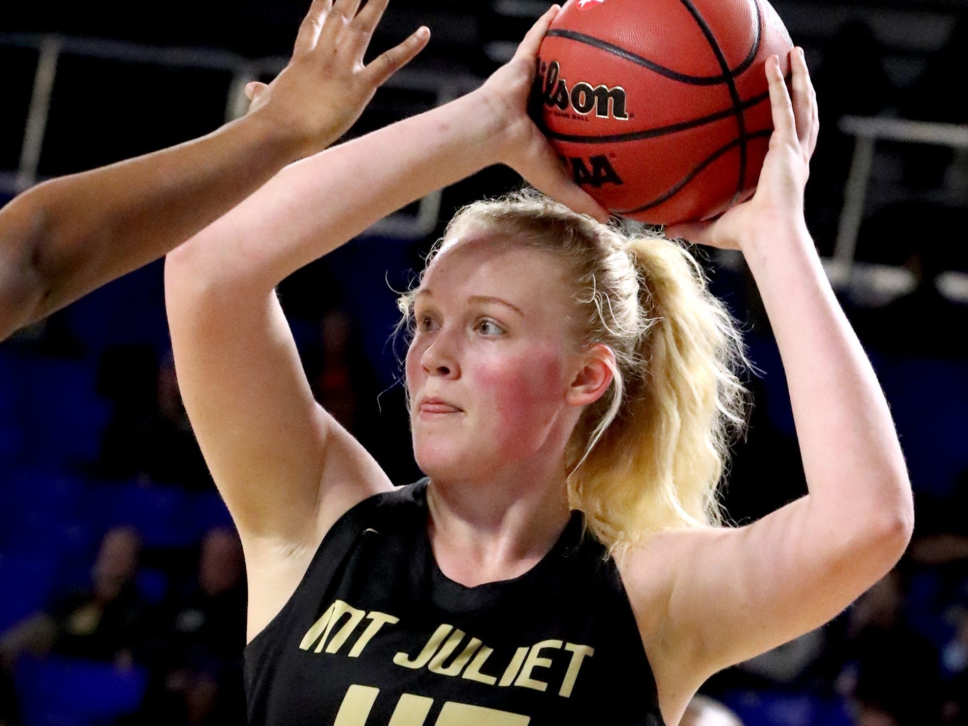 Mt. Juliet's Emma Palmer (45) looks for a player to pass to during the quarterfinal round of the TSSAA Div. 1 Class AAA Girls State Tournament Houston, on Wednesday, March 6, 2019, at Murphy Center in Murfreesboro, Tenn.