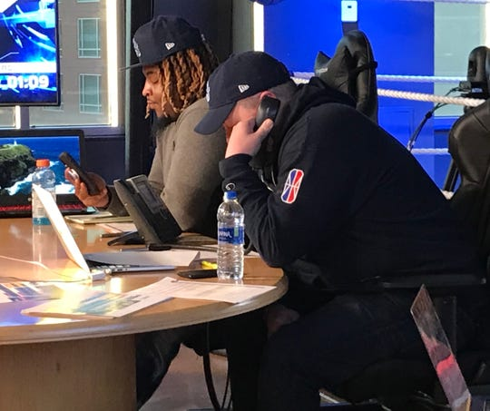 Grizz Gaming general manager Lang Whitaker talks on the phone as the team prepares to make its second round selection during the NBA 2K League draft on Tuesday night.