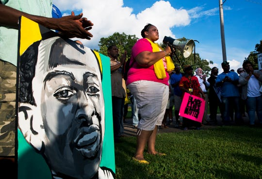 July 24, 2015 - Tami Sawyer speaks during a vigil honoring Darrius Stewart at New Direction Youth Campus in Hickory Hill. Stewart, 19, was killed by a Memphis police officer during a traffic stop.