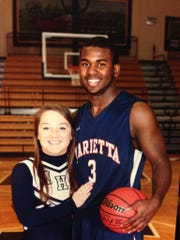 Childhood friend Claire Dodd and Raynere Thornton at Marietta High School.