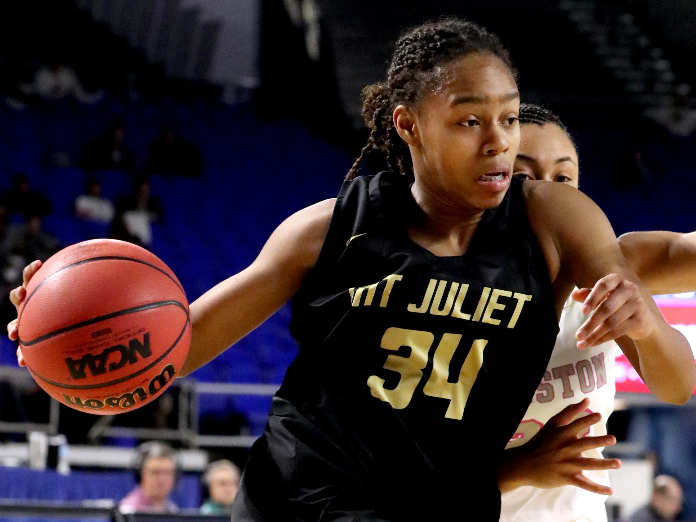 Mt. Juliet's Tondriannha Davis (34) drives to the basket around Houston's Madison Griggs (23) during the quarterfinal round of the TSSAA Div. 1 Class AAA Girls State Tournament, on Wednesday, March 6, 2019, at Murphy Center in Murfreesboro, Tenn.