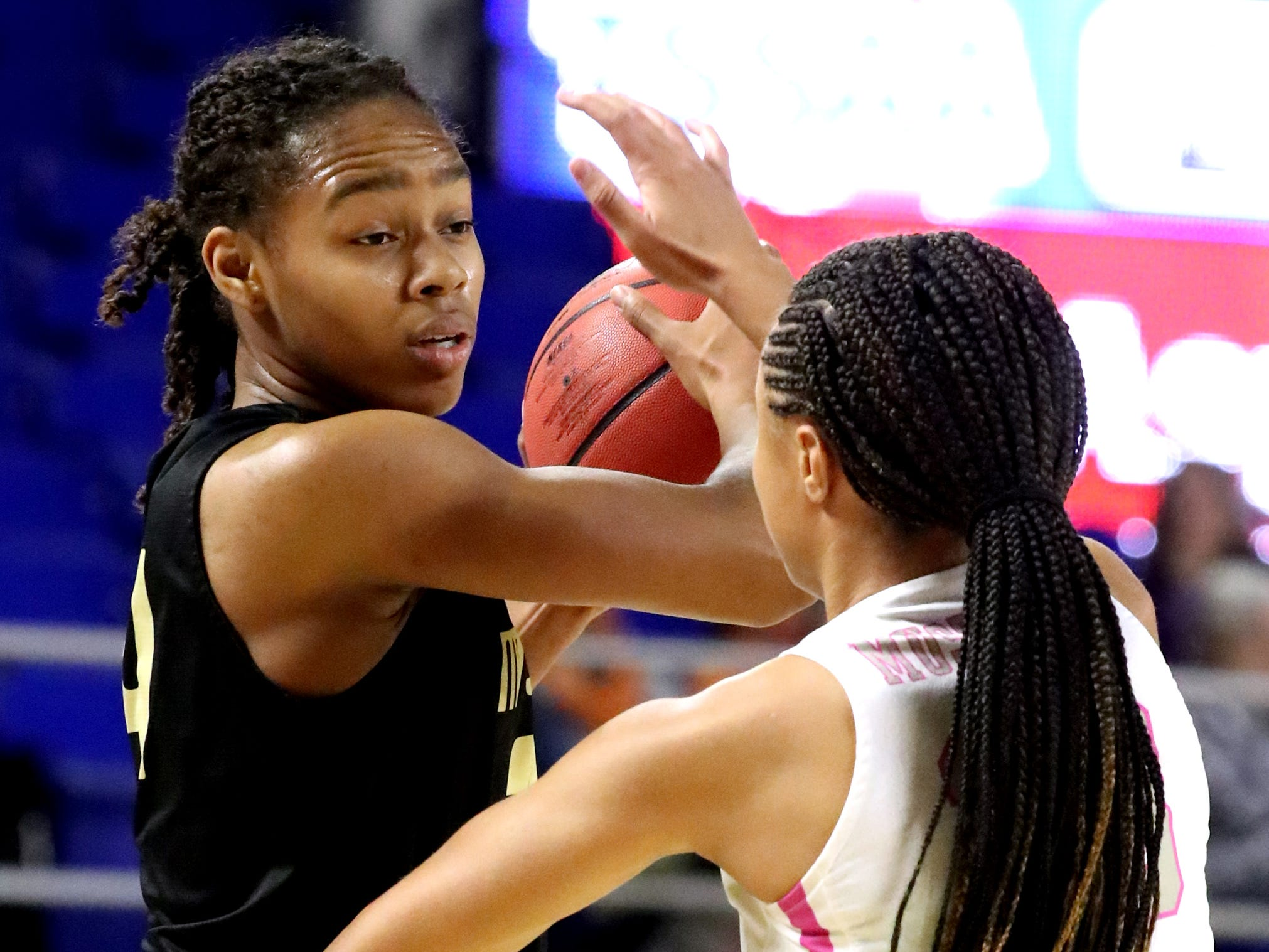 Mt. Juliet's Tondriannha Davis (34) looks for an opening to the basket as Houston's Madison Griggs (23) guards her during the quarterfinal round of the TSSAA Div. 1 Class AAA Girls State Tournament, on Wednesday, March 6, 2019, at Murphy Center in Murfreesboro, Tenn.