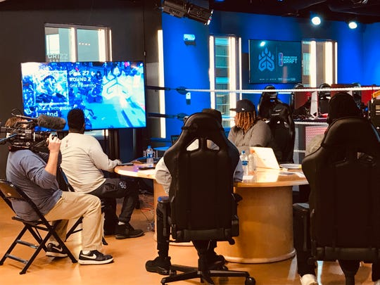 The Grizz Gaming leadership team watches as the team's second round pick in the NBA 2K League draft is announced on Tuesday night.