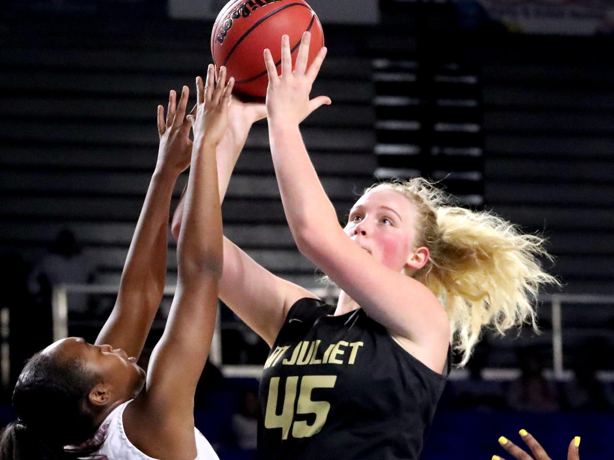 Mt. Juliet's Nevaeh Majors (24) shoots the ball ass Houston's Destinee Wells (24) guards her during the quarterfinal round of the TSSAA Div. 1 Class AAA Girls State Tournament, on Wednesday, March 6, 2019, at Murphy Center in Murfreesboro, Tenn.