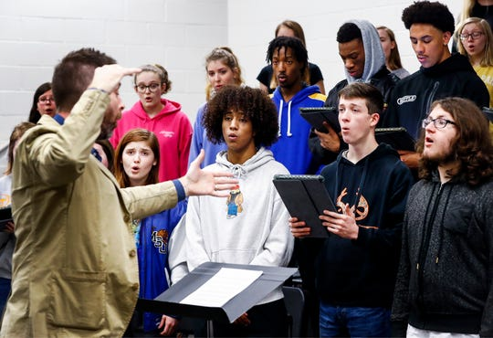 "Members of the Arlington High School Chorale perform the song ""Irish Blessings"" during a recent rehearsal. A group of 40 student will travel to Normandy, France, in 2020 to perform in the closing commemoration ceremonies of the D-Day remembrance event."