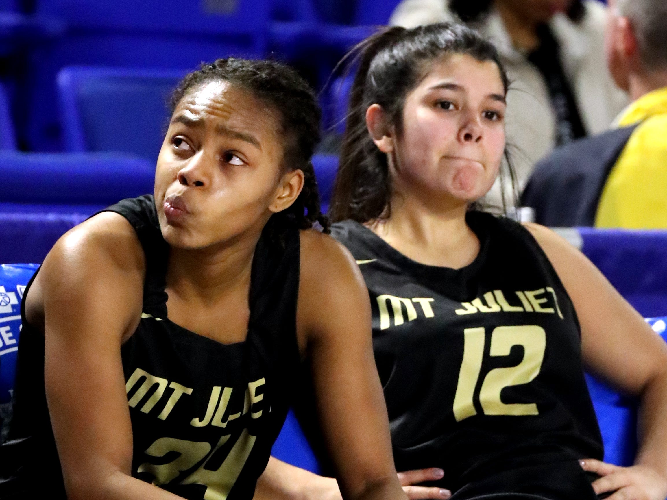 Mt. Juliet's Nevaeh Majors (24) and Ryleigh Osborne (12) react to losing in the final seconds of the game against the Houston during the quarterfinal round of the TSSAA Div. 1 Class AAA Girls State Tournament, on Wednesday, March 6, 2019, at Murphy Center in Murfreesboro, Tenn.