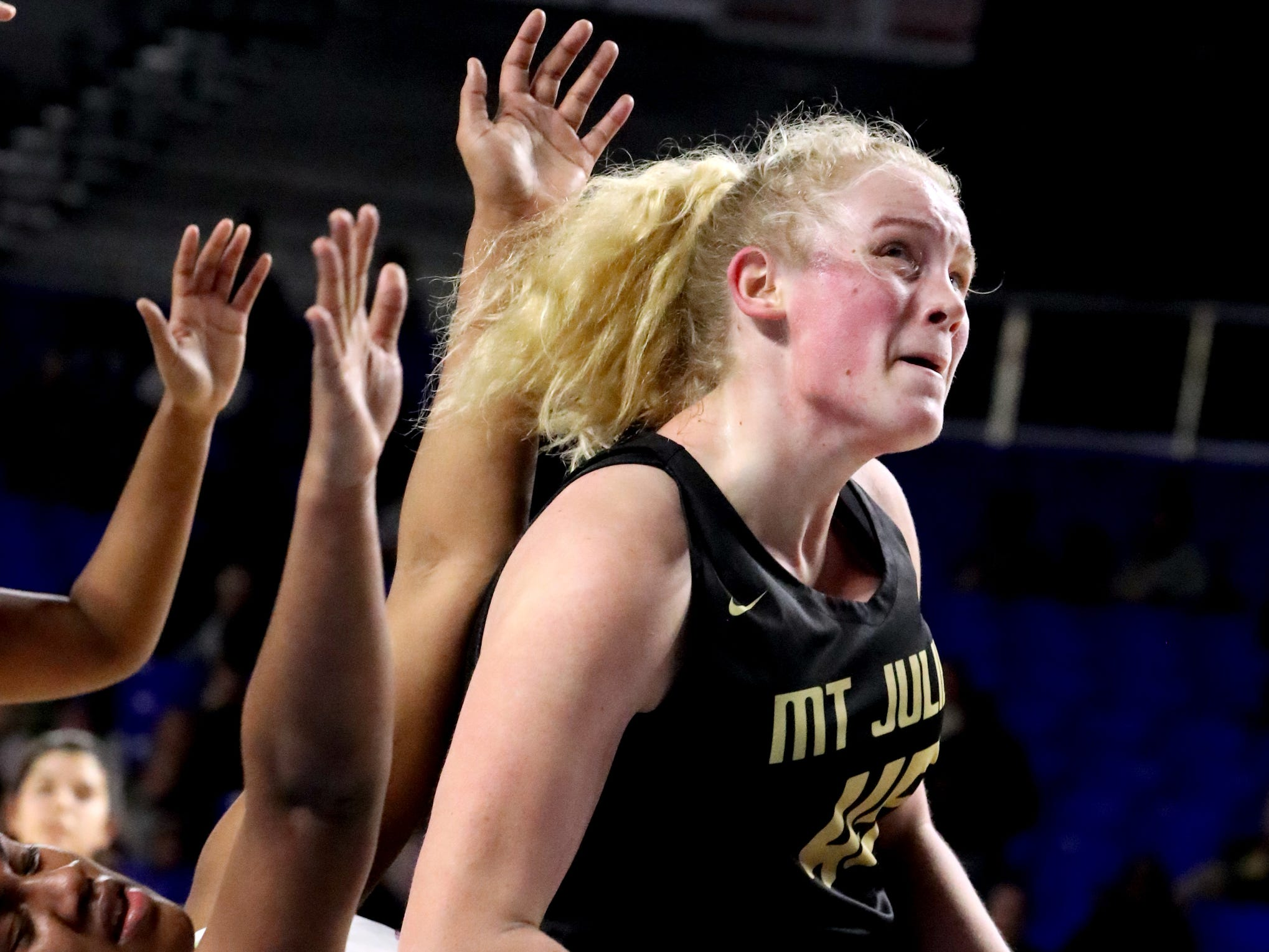 Mt. Juliet's Emma Palmer (45) pushes to the basket as Houston's Melisa Carter (33) falls during the quarterfinal round of the TSSAA Div. 1 Class AAA Girls State Tournament, on Wednesday, March 6, 2019, at Murphy Center in Murfreesboro, Tenn.