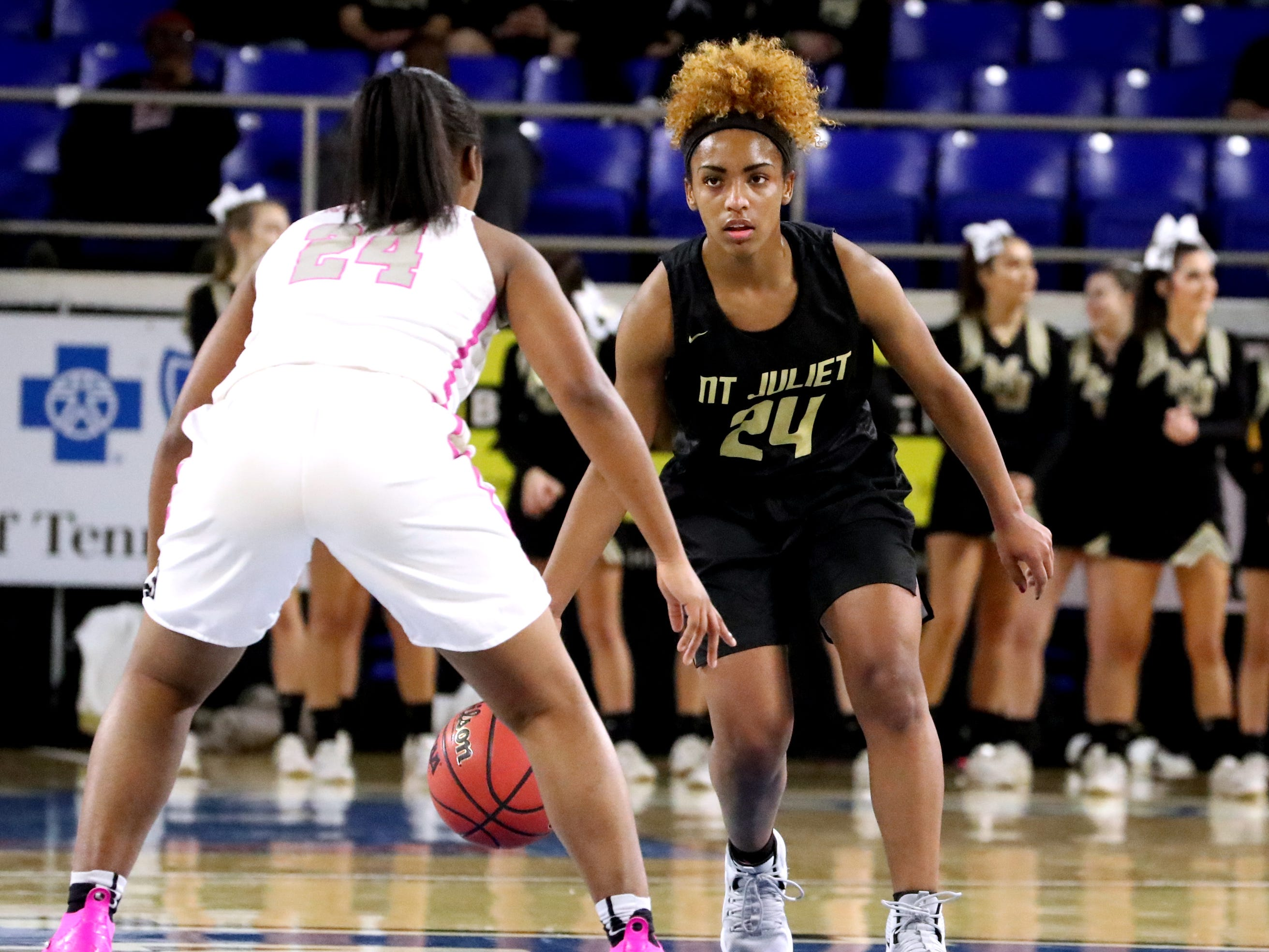 Mt. Juliet's Nevaeh Majors (24) brings the ball up court as Houston's Destinee Wells (24) guards her during the quarterfinal round of the TSSAA Div. 1 Class AAA Girls State Tournament, on Wednesday, March 6, 2019, at Murphy Center in Murfreesboro, Tenn.