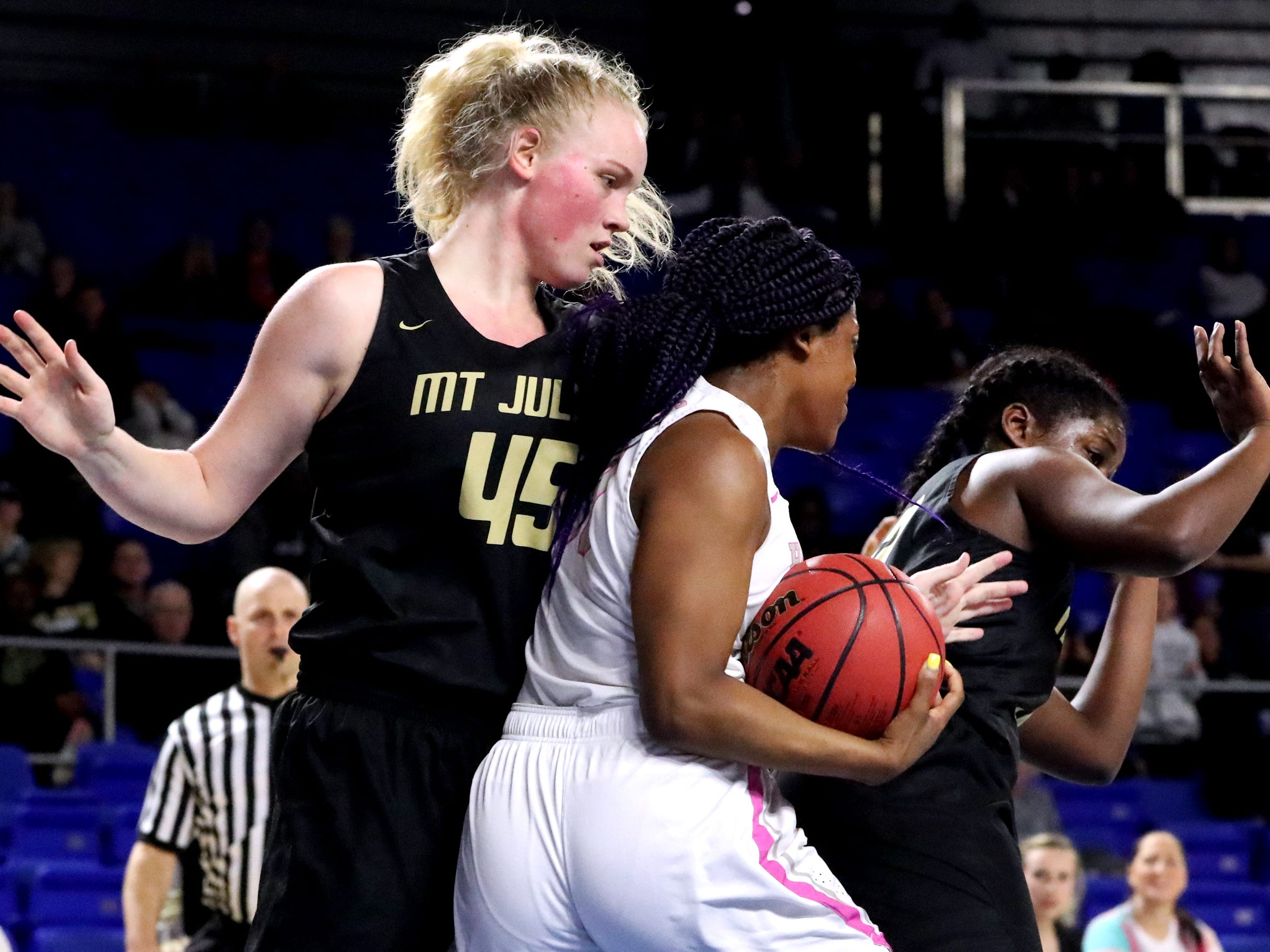 Houston's Jayla Hemingway (00) tries to shake off her defenders Mt. Juliet's Emma Palmer (45) and Reghan Grimes (33) during the quarterfinal round of the TSSAA Div. 1 Class AAA Girls State Tournament, on Wednesday, March 6, 2019, at Murphy Center in Murfreesboro, Tenn.