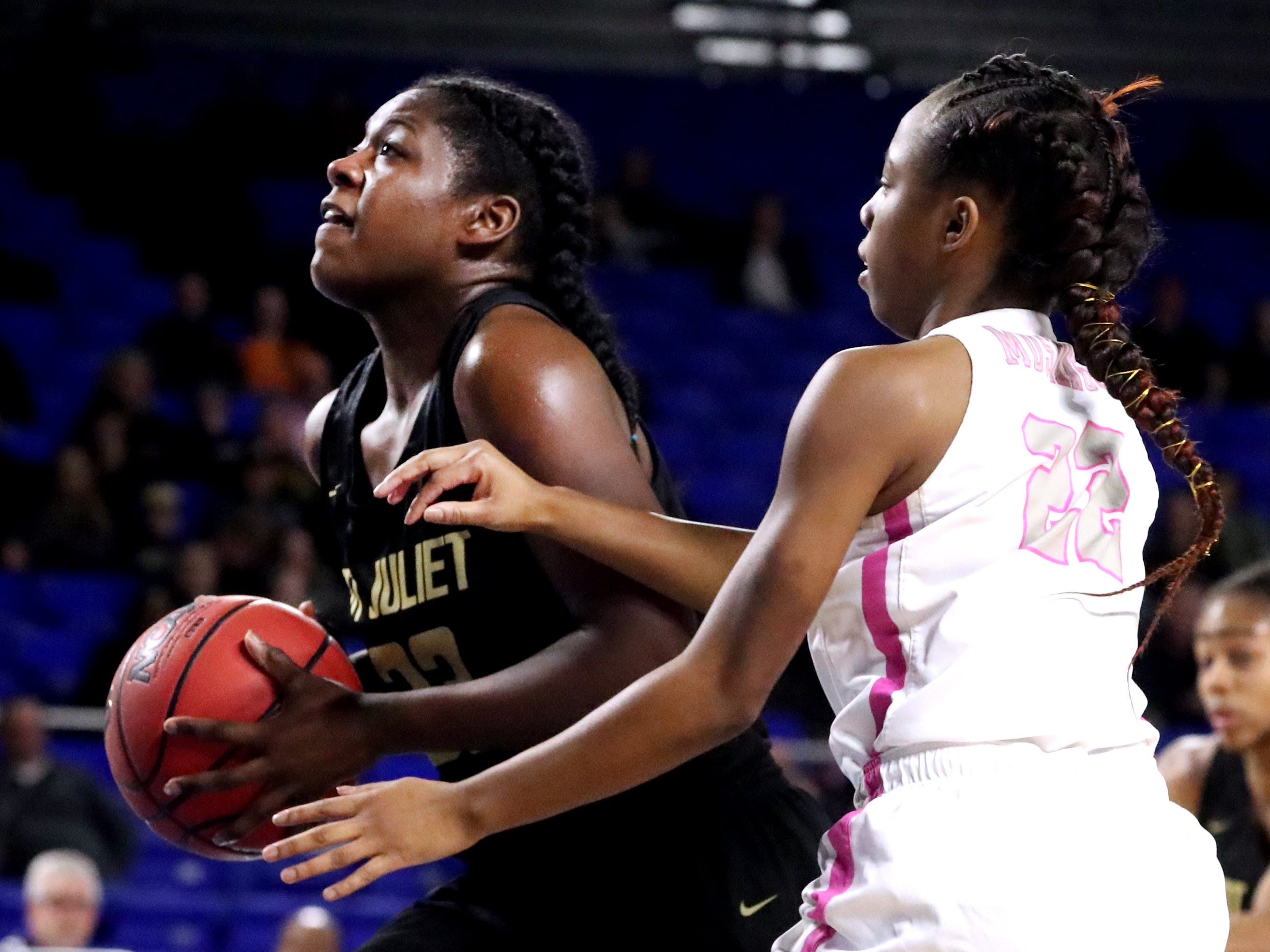 Mt. Juliet's Reghan Grimes (33) heads to the basket as Houston's Nakiyah Westbrook (22) guards her during the quarterfinal round of the TSSAA Div. 1 Class AAA Girls State Tournament, on Wednesday, March 6, 2019, at Murphy Center in Murfreesboro, Tenn.