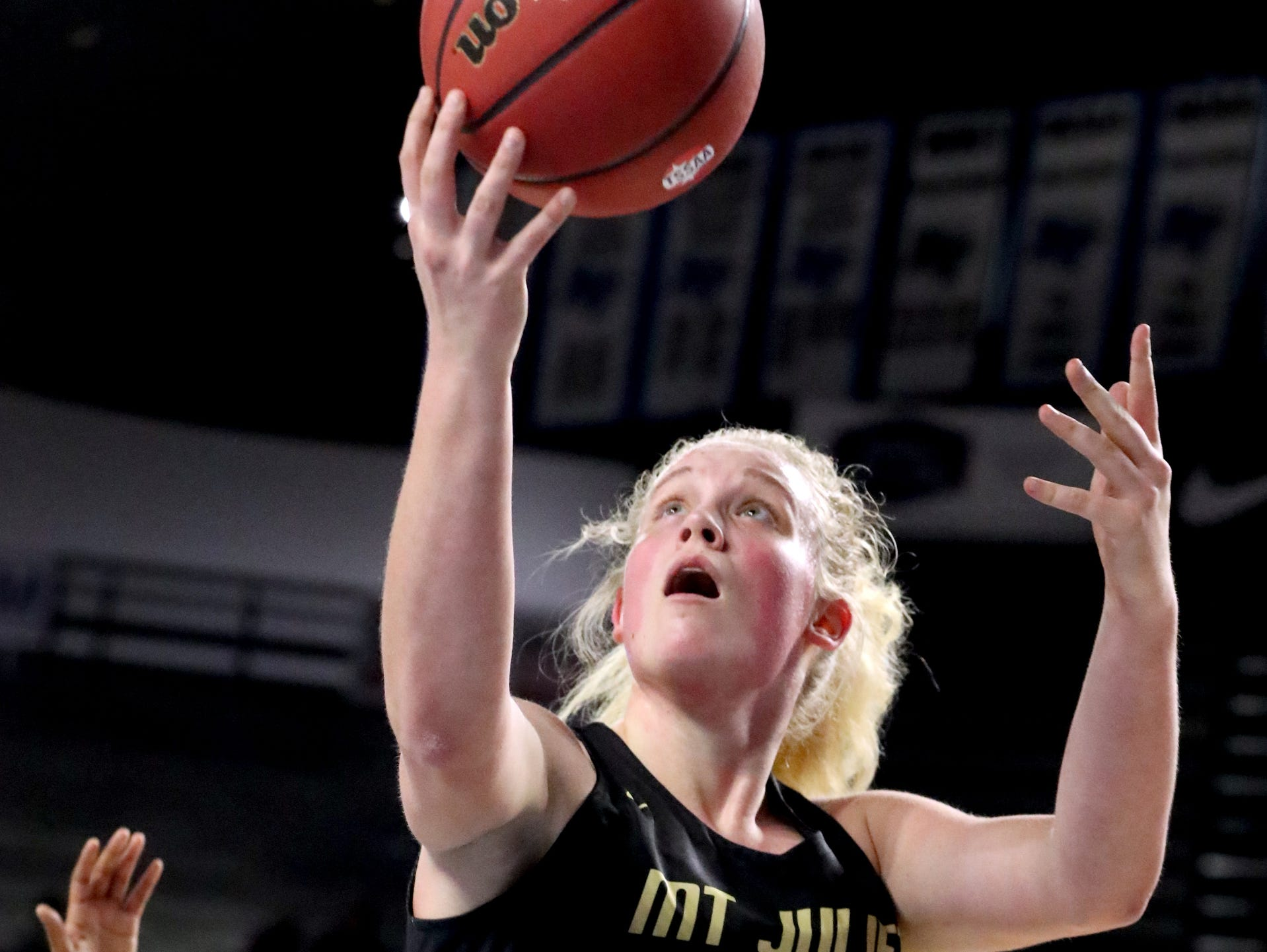 Mt. Juliet's Emma Palmer (45) shoots the ball during the quarterfinal round of the TSSAA Div. 1 Class AAA Girls State Tournament against the Houston, on Wednesday, March 6, 2019, at Murphy Center in Murfreesboro, Tenn.