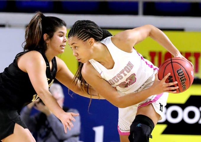 Houston's Madison Griggs (23) looks for a way to the basket as Mt. Juliet's Ryleigh Osborne (12) guards her during the quarterfinal round of the TSSAA Div. 1 Class AAA Girls State Tournament, on Wednesday, March 6, 2019, at Murphy Center in Murfreesboro, Tenn.