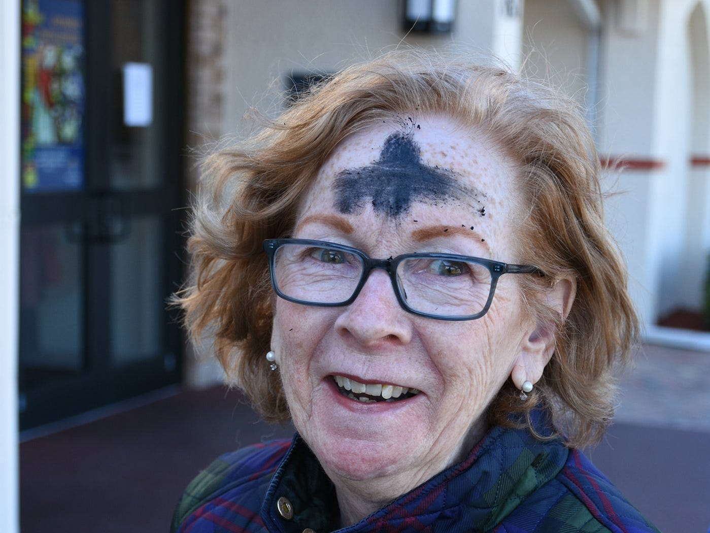 Janet Heckin leaves San Marco Catholic Church with her forehead decorated with ashes. Catholics on Marco Island and around the world, along with many other Christians, celebrated Ash Wednesday by attending mass and having a cross drawn on their foreheads in ashes.