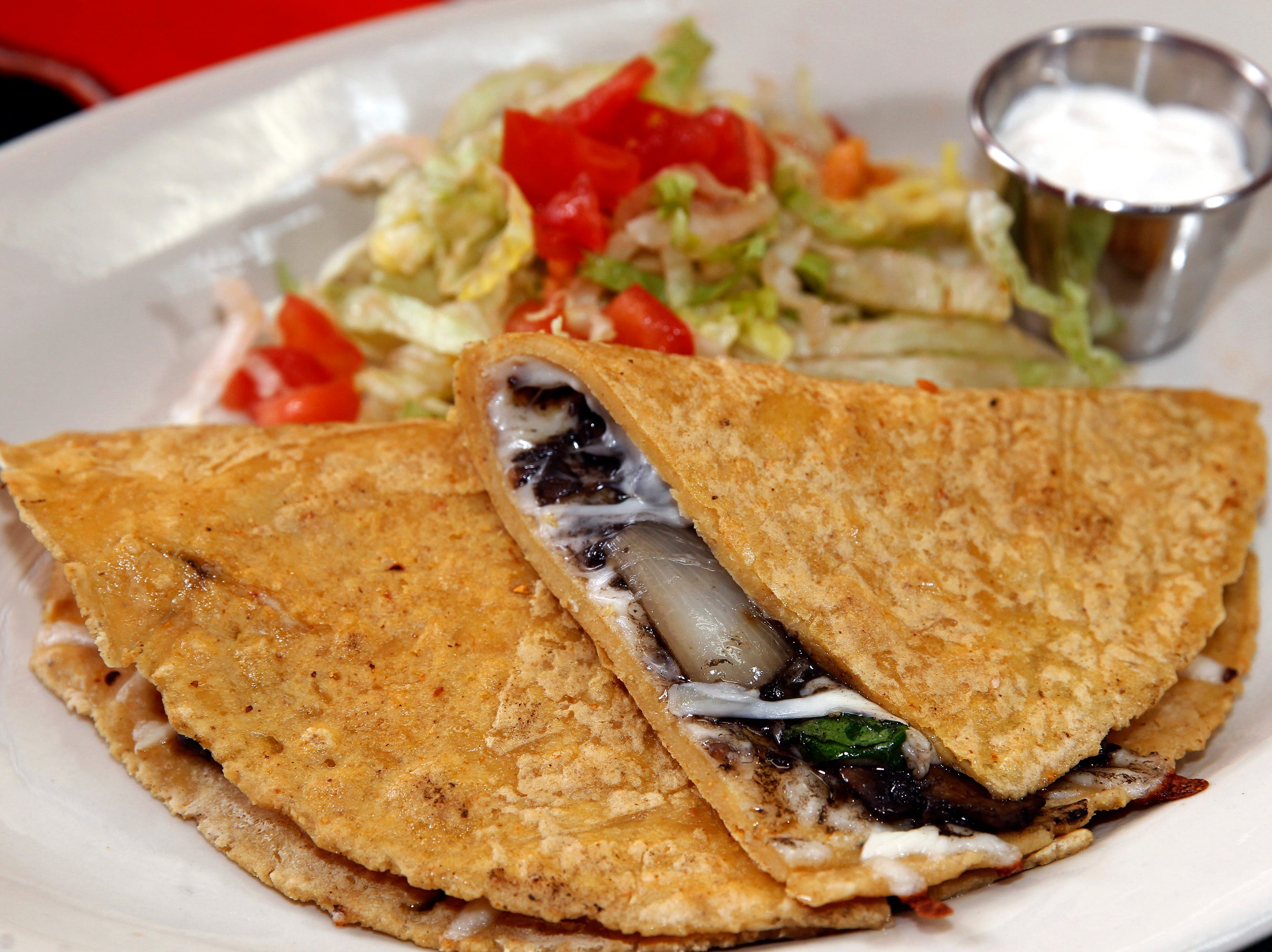 Fillings for handmade quesadillas include huitlacoche, the corn mushroom, at El Tlaxcalteca.