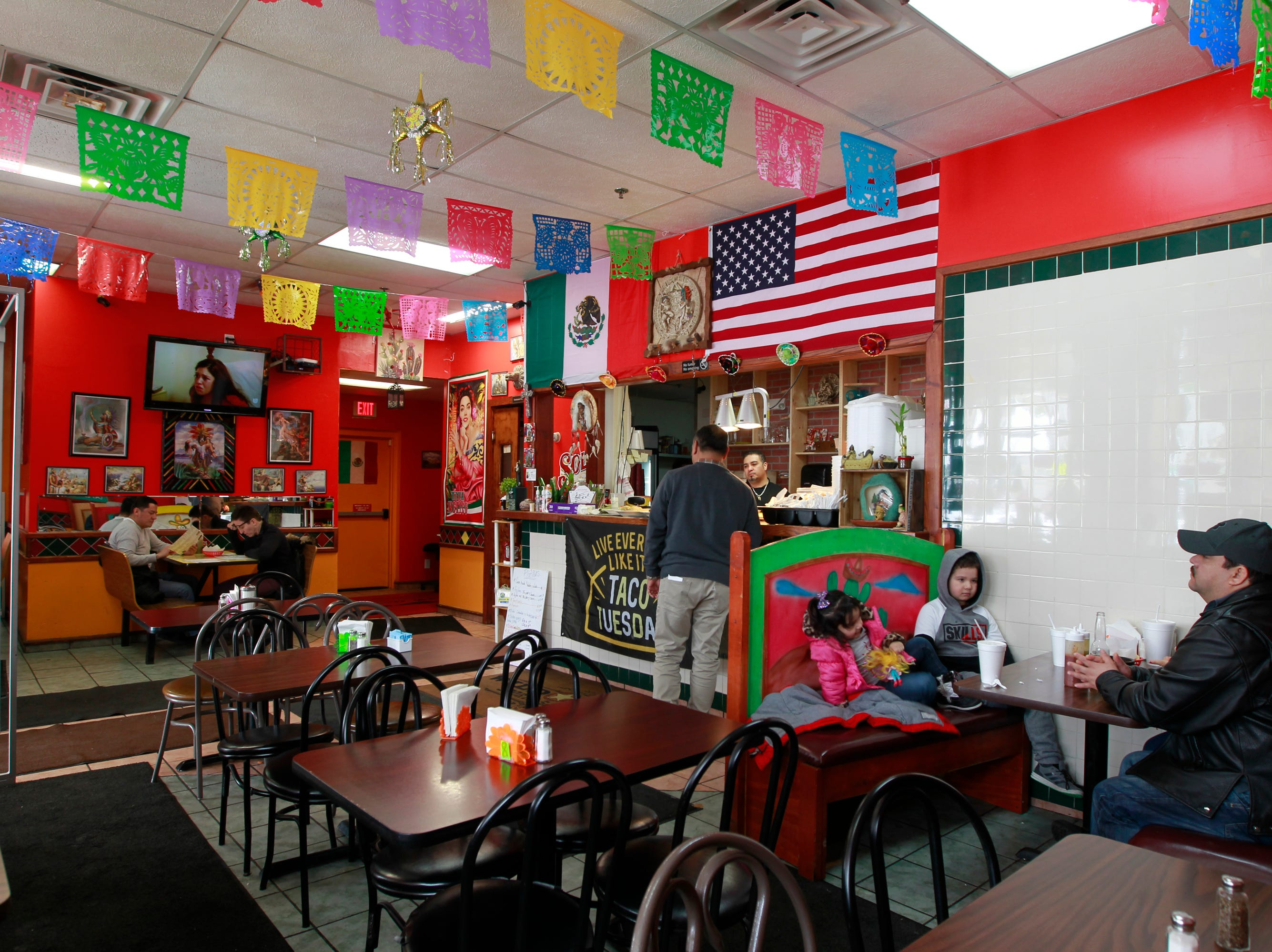 Customers begin to fill the tables at lunchtime at El Tlaxcalteca. The small storefront restaurant, which seats 46, is in a plaza at 13th and Burnham that also holds an El Rey supermarket.