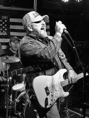 Eddie Topple of New Berlin is in a band called The American Patriots.