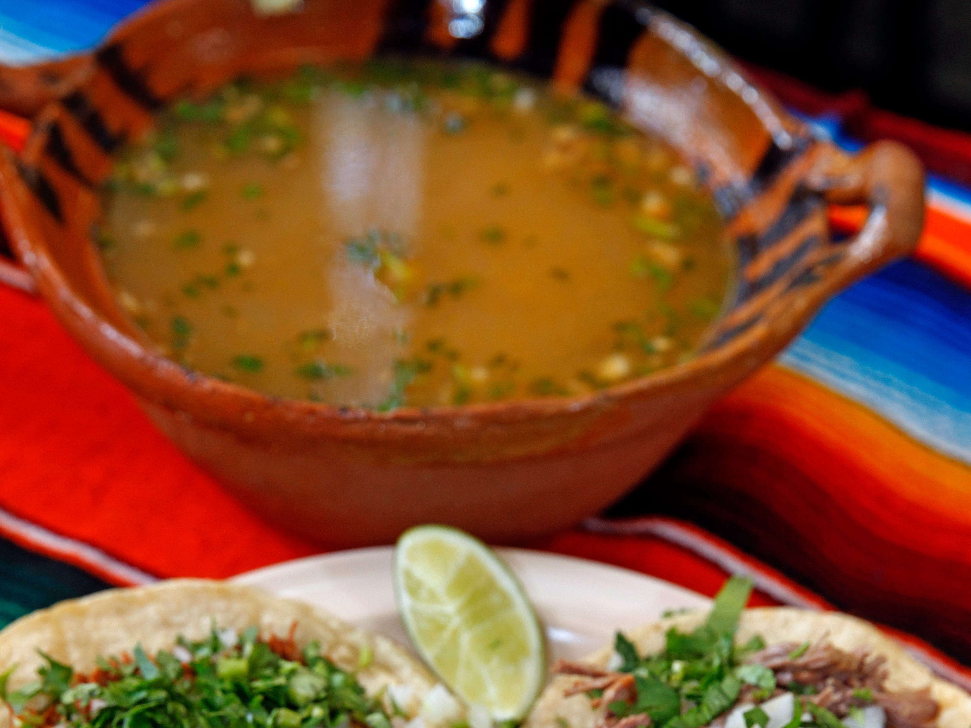 A specialty at El Tlaxcalteca is the consome de borrego, a large bowl of lamb soup that is served alongside lamb tacos.