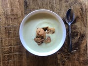 Pureed cauliflower soup is even better topped with croutons or other crunchy things.