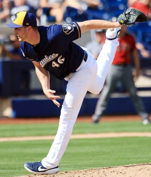 Brewers reliever Corey Knebel, shown during spring training in 2019, had Tommy John surgery April 3 and will not pitch in any exhibition games.