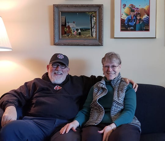 "Richard Spransy puts his arm around his ""hot chick,"" also known as his wife, Nancy. The ice car racer from Wauwatosa shows no signs of slowing down."