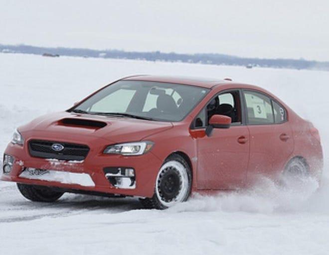 Richard Spransy, 73, of Wauwatosa races his car on frozen Lake Poygan.