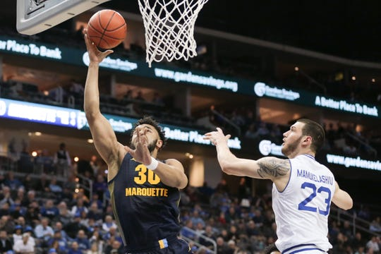 Marquette forward Ed Morrow shoots the ball as Seton Hall forward Sandro Mamukelashvili defends during the first half Wednesday.
