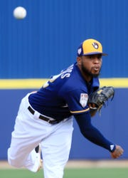 Brewers reliever Jeremy Jeffress releases a pitch against the Diamondbacks in his abbreviated first outing of Cactus League play this season.