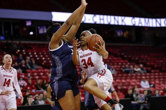Wisconsin's Imani Lewis drives into Penn State's Lauren Ebo in an earlier game this year. Lewis had 17 points on Wednesday afternoon.