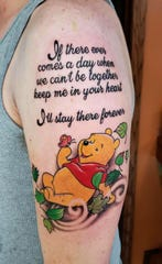 """Last month, Nick Beaudin had his wife Carlie's favorite quote from Winnie-the-Pooh tattoed on his arm.  When he looks at it, he gets the feeling """"she's trying to help however she can."""""""