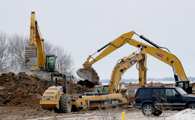 Work continues March 7, 2019, near the Foxconn Technology Group complex under construction in Mount Pleasant.
