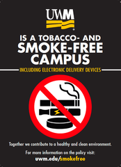 UWM police officers are handing out information cards regarding the new tobacco-free policy.
