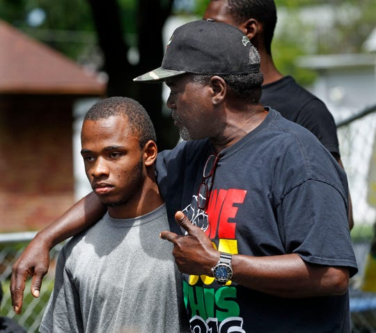 """Andre Lee Ellis, founder and director of """"We Got This,"""" comforts Devin Bell, 17, who shared with his peers some of his struggles during the """"We Got This"""" summer program in June."""