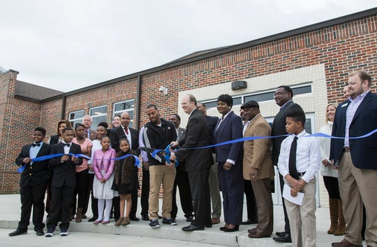 City officials and students perform the ceremonial ribbon cutting outside Barkdull Faulk Elementary in Monroe, La. to celebrate the opening of the new gym and cafeteria on March 7.